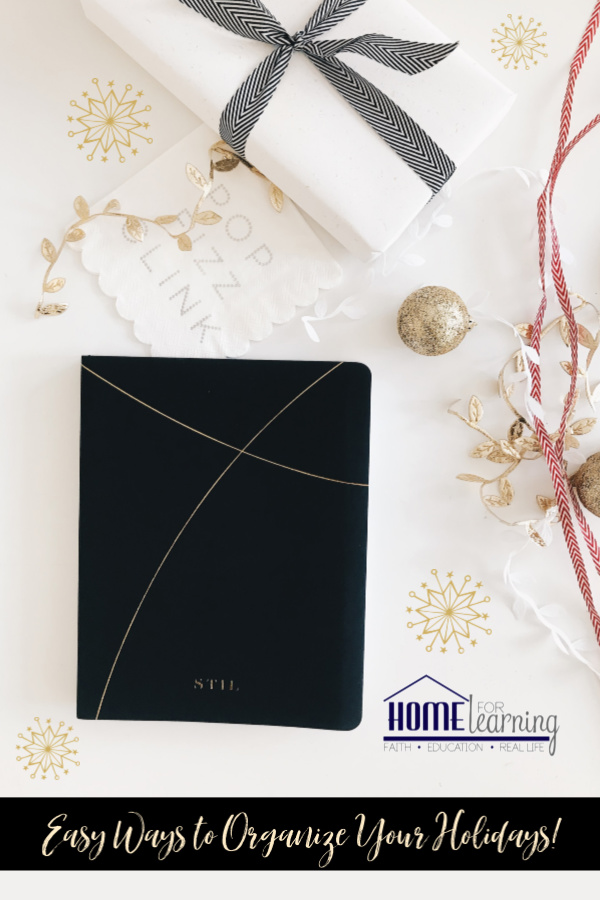 A holiday planner on a cream colored background with Christmas Gifts and ornaments.
