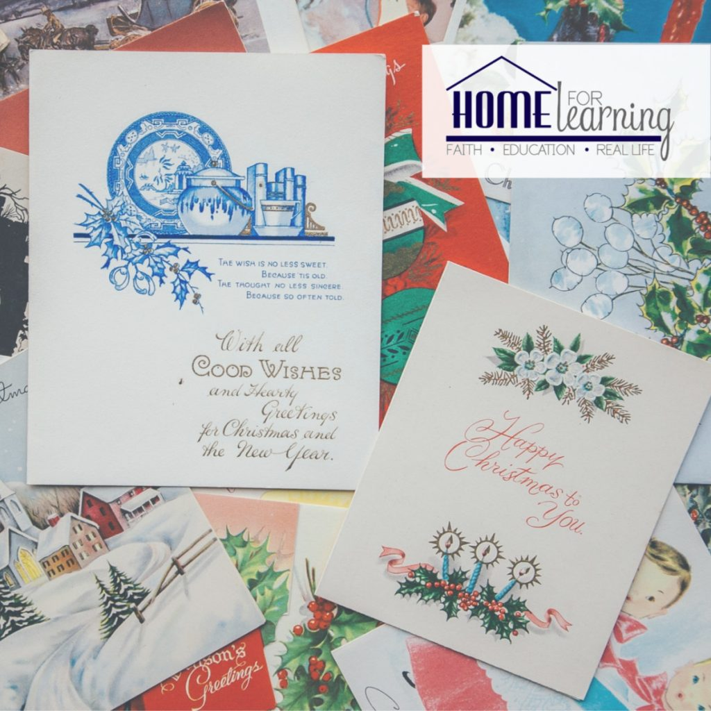 A group of colorful christmas cards laid out on a table.